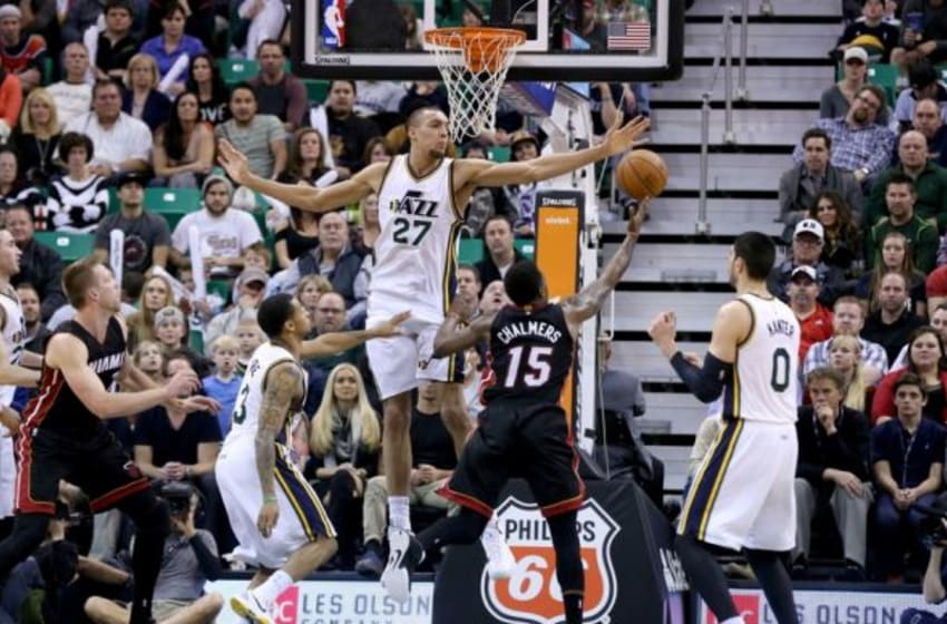 Dec 12, 2014; Salt Lake City, UT, USA; Utah Jazz center Rudy Gobert (27) tries to block the shot of Miami Heat guard Mario Chalmers (15) during the fourth quarter at EnergySolutions Arena. Miami Heat won the game 100-95. Mandatory Credit: Chris Nicoll-USA TODAY Sports