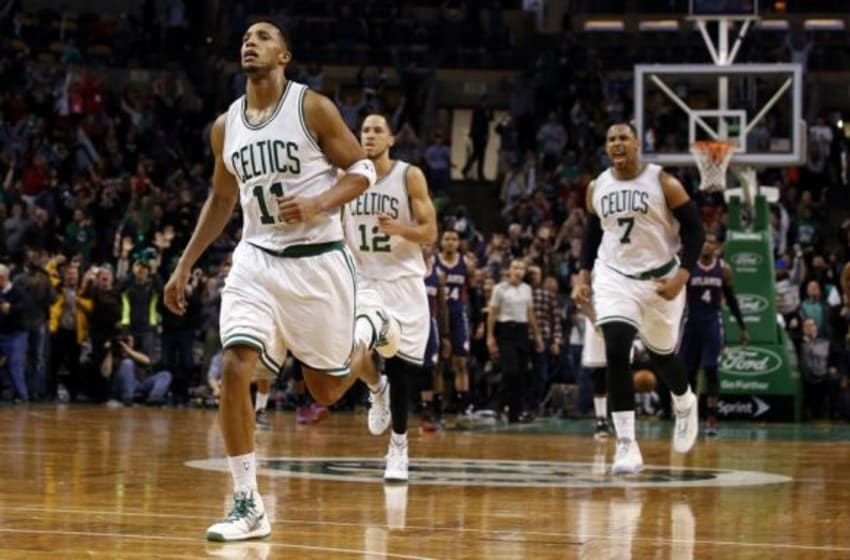 Feb 11, 2015; Boston, MA, USA; Boston Celtics guard Evan Turner (11) and his teammates react after shooting the winning basket against the Atlanta Hawks in the final seconds of play at TD Garden. The Celtics defeated Atlanta 89-88. Mandatory Credit: David Butler II-USA TODAY Sports