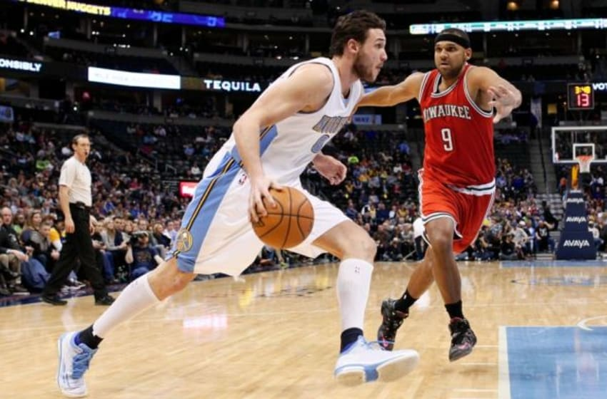 Mar 3, 2015; Denver, CO, USA; Denver Nuggets forward Danilo Gallinari (8) dribbles the ball against Milwaukee Bucks guard Jared Dudley (9) in the third quarter at Pepsi Center. The Nuggets defeated the Bucks 106-95. Mandatory Credit: Isaiah J. Downing-USA TODAY Sports