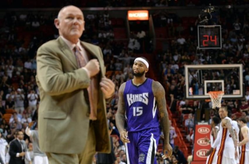Mar 7, 2015; Miami, FL, USA; Sacramento Kings center DeMarcus Cousins (right) walks back to the bench after head coach George Karl (left) called timeout against the Miami Heat during the second half at American Airlines Arena. The Heat won in overtime 114-109. Mandatory Credit: Steve Mitchell-USA TODAY Sports