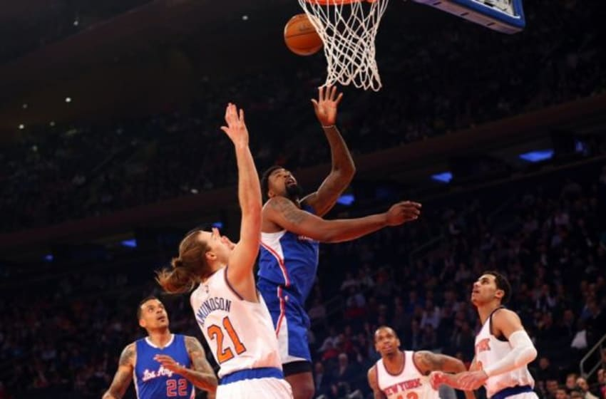 Mar 25, 2015; New York, NY, USA; Los Angeles Clippers center DeAndre Jordan (6) shoots over New York Knicks forward Lou Amundson (21) during the first quarter at Madison Square Garden. Mandatory Credit: Anthony Gruppuso-USA TODAY Sports