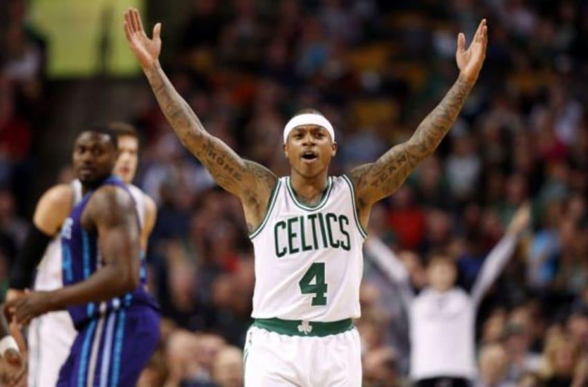 Feb 27, 2015; Boston, MA, USA; Boston Celtics guard Isaiah Thomas (4) celebrates after making a three point shot during the second half of the Boston Celtics 106-98 win over the Charlotte Hornets at TD Garden. Mandatory Credit: Winslow Townson-USA TODAY Sports