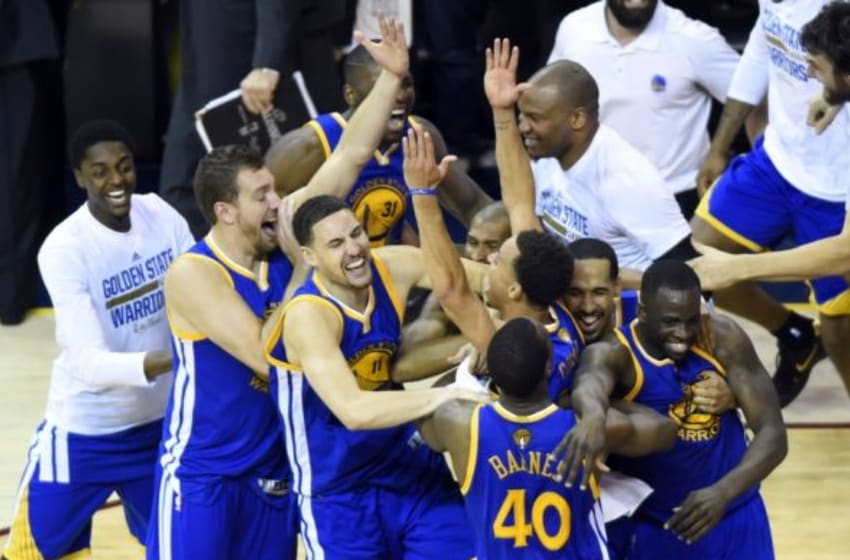 Jun 16, 2015; Cleveland, OH, USA; The Golden State Warriors celebrate after winning game six of the NBA Finals against the Cleveland Cavaliers at Quicken Loans Arena. Warriors won 105-97. Mandatory Credit: Ken Blaze-USA TODAY Sports