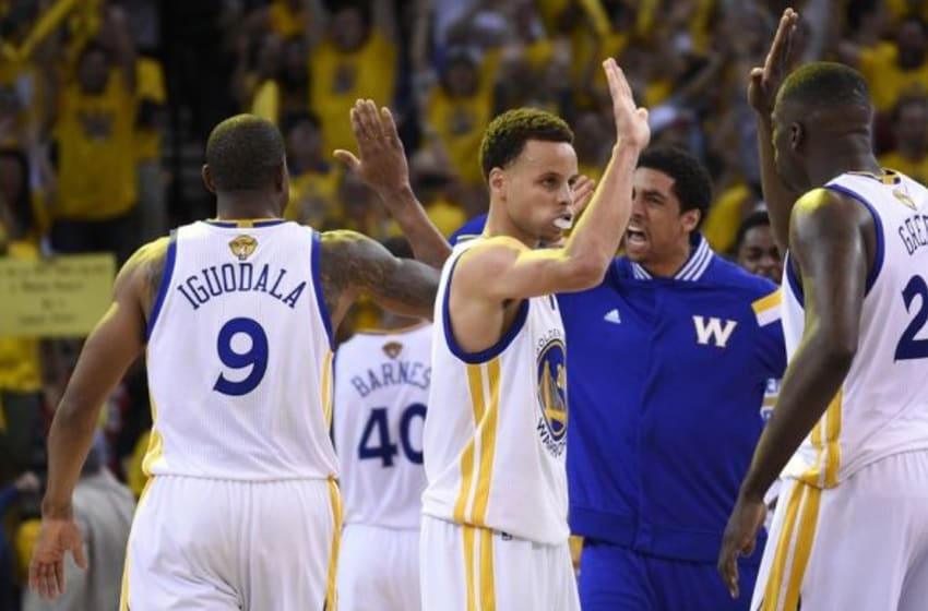 June 4, 2015; Oakland, CA, USA; Golden State Warriors guard Stephen Curry (30) celebrates a scoring play during a time out against the Cleveland Cavaliers in the overtime period in game one of the NBA Finals. at Oracle Arena. Mandatory Credit: Kyle Terada-USA TODAY Sports