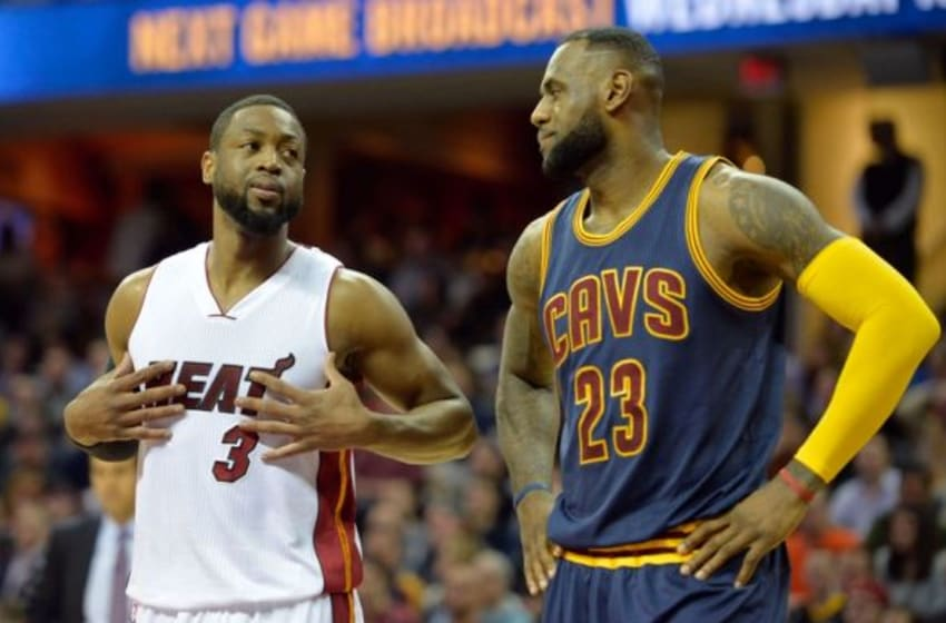 Apr 2, 2015; Cleveland, OH, USA; Miami Heat guard Dwyane Wade (3) and Cleveland Cavaliers forward LeBron James (23) look on in the first quarter at Quicken Loans Arena. Mandatory Credit: David Richard-USA TODAY Sports