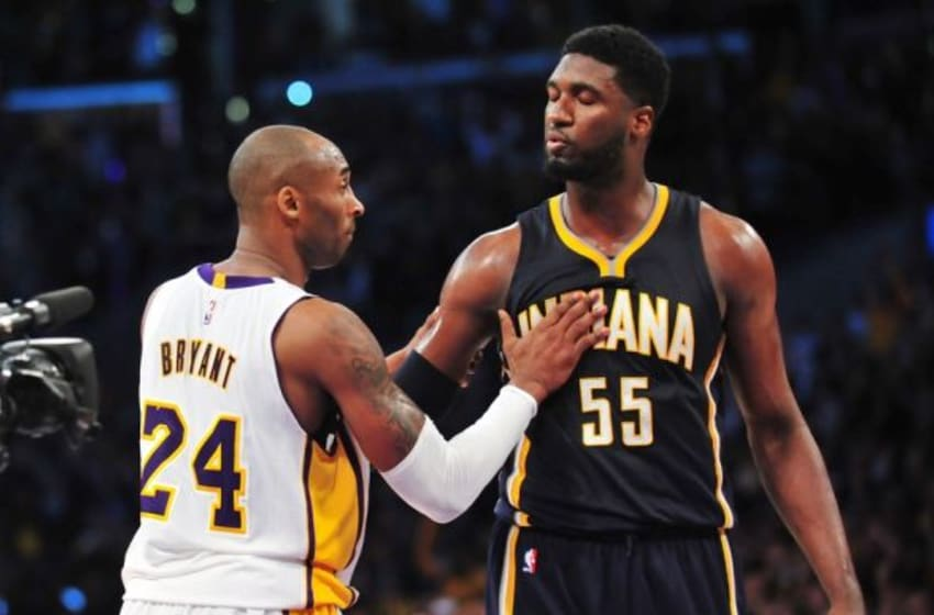 January 4, 2015; Los Angeles, CA, USA; Los Angeles Lakers guard Kobe Bryant (24) meets with Indiana Pacers center Roy Hibbert (55) following the 88-87 victory at Staples Center. Mandatory Credit: Gary A. Vasquez-USA TODAY Sports