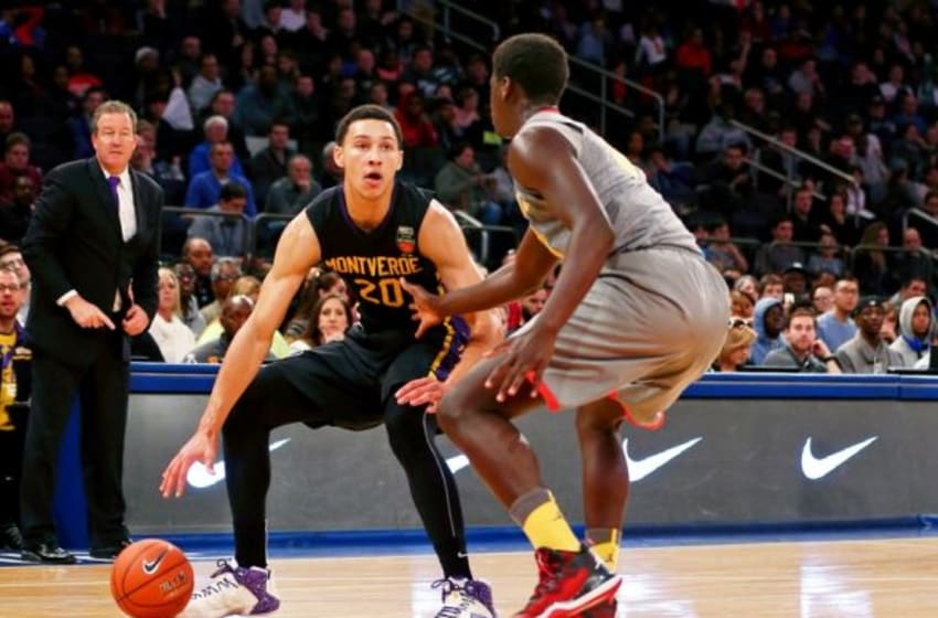 Apr 4, 2015; New York, NY, USA; Oak Hill Academy forward Khadim Sy (31) defends as Montverde Academy guard/forward Ben Simmons (20) plays the ball during the second half during the Dick's Sporting Goods High School Nationals boys final game at at Madison Square Garden. Montverde defeated Oak Hill 70-61 to win the national championship. Mandatory Credit: Andy Marlin-USA TODAY Sports