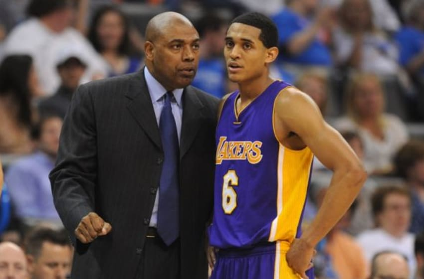 Mar 24, 2015; Oklahoma City, OK, USA; Lakers assistant coach Paul Pressey speaks to Los Angeles Lakers guard Jordan Clarkson (6) during a break in action against the Oklahoma City Thunder at Chesapeake Energy Arena. Mandatory Credit: Mark D. Smith-USA TODAY Sports