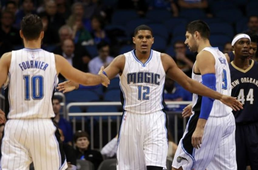 Oct 21, 2015; Orlando, FL, USA; Orlando Magic forward Tobias Harris (12) high fives guard Evan Fournier (10) and teammates against the New Orleans Pelicans during the first quarter at Amway Center. Mandatory Credit: Kim Klement-USA TODAY Sports