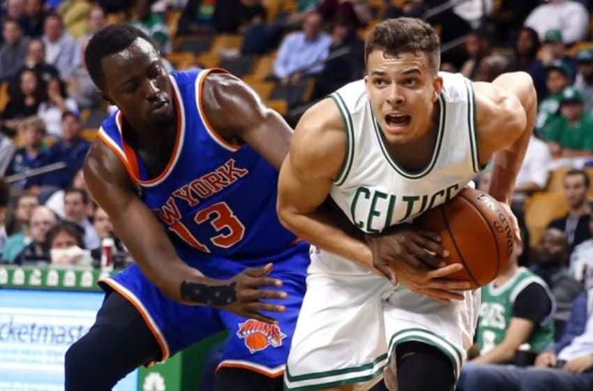 Oct 22, 2015; Boston, MA, USA; New York Knicks guard Jerian Grant (13) tries to steal the ball from Boston Celtics guard R.J. Hunter (28) during the second half of the Boston Celtics 99-85 win over the New York Knicks at TD Garden. Mandatory Credit: Winslow Townson-USA TODAY Sports