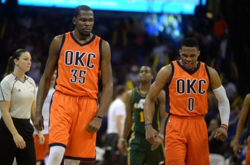 Dec 13, 2015; Oklahoma City, OK, USA; Oklahoma City Thunder forward Kevin Durant (35) and Thunder guard Russell Westbrook (0) react after a play against the Utah Jazz during the fourth quarter at Chesapeake Energy Arena. Mandatory Credit: Mark D. Smith-USA TODAY Sports