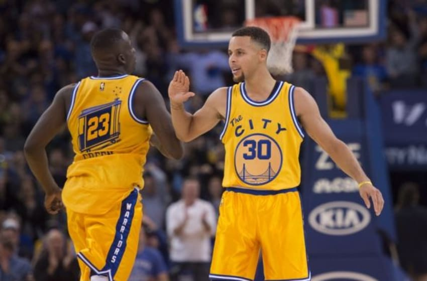 November 17, 2015; Oakland, CA, USA; Golden State Warriors forward Draymond Green (23) celebrates with guard Stephen Curry (30) against the Toronto Raptors during the fourth quarter at Oracle Arena. The Warriors defeated the Raptors 115-110. Mandatory Credit: Kyle Terada-USA TODAY Sports