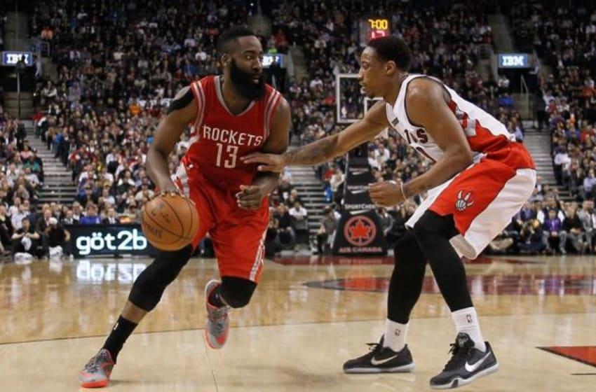 Mar 30, 2015; Toronto, Ontario, CAN; Houston Rockets guard James Harden (13) tries to get around Toronto Raptors guard DeMar DeRozan (10) at the Air Canada Centre. Toronto defeated Houston 99-96. Mandatory Credit: John E. Sokolowski-USA TODAY Sports