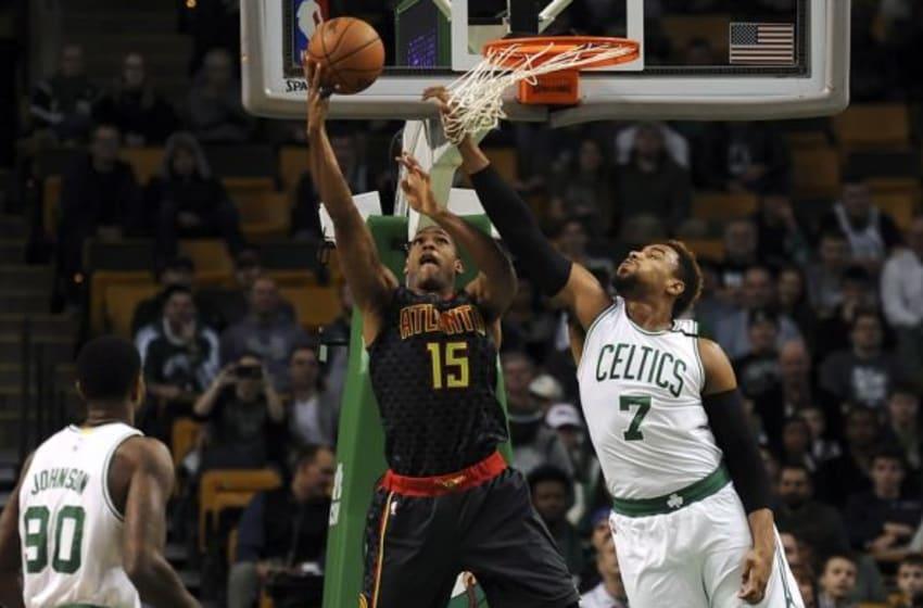 Dec 18, 2015; Boston, MA, USA; Atlanta Hawks center Al Horford (15) lays the ball in the basket past Boston Celtics center Jared Sullinger (7) during the first half at TD Garden. Mandatory Credit: Bob DeChiara-USA TODAY Sports