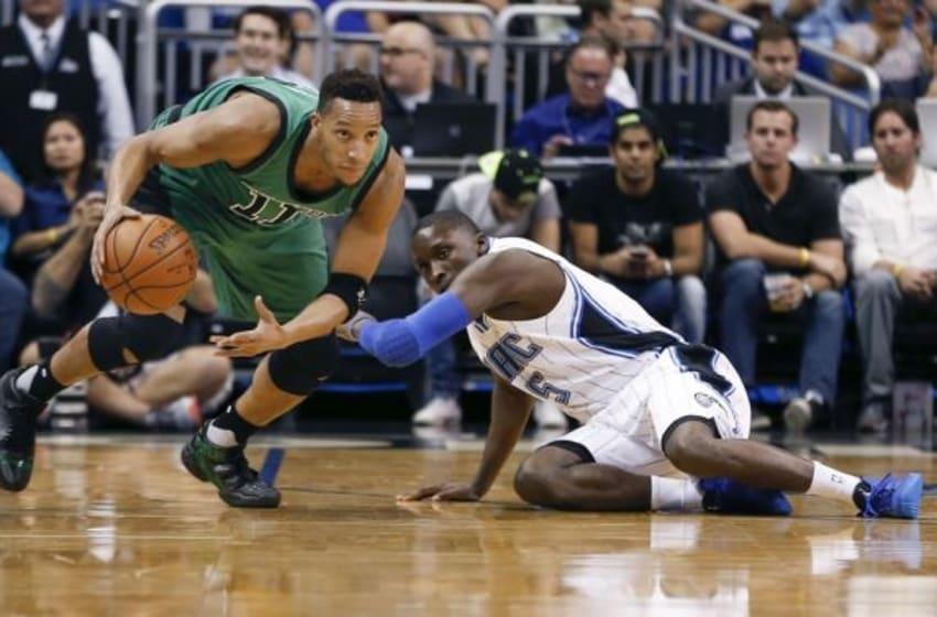 Nov 29, 2015; Orlando, FL, USA; Orlando Magic guard Victor Oladipo (5) falls as Boston Celtics guard Evan Turner (11) drives the ball during the first quarter of a basketball game at Amway Center. Mandatory Credit: Reinhold Matay-USA TODAY Sports