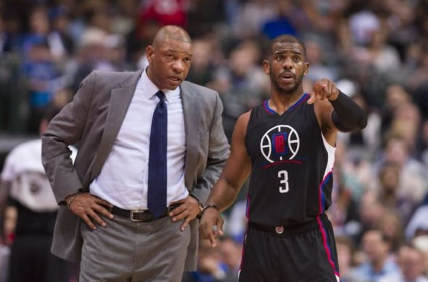 Mar 7, 2016; Dallas, TX, USA; Los Angeles Clippers head coach Doc Rivers and guard Chris Paul (3) talk during a stoppage in play against the Dallas Mavericks during the second half at the American Airlines Center. The Clippers defeat the Mavericks 109-90. Mandatory Credit: Jerome Miron-USA TODAY Sports