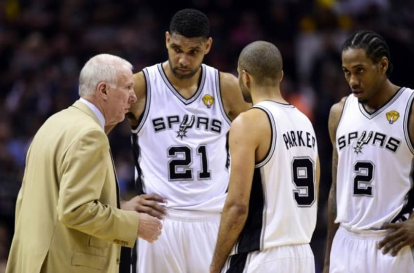 Jun 8, 2014; San Antonio, TX, USA; San Antonio Spurs head coach Gregg Popovich talks to forward Tim Duncan (21) guard Tony Parker (9) and forward Kawhi Leonard (2) against the Miami Heat in game two of the 2014 NBA Finals at AT&T Center. The Heat won 98-96. Mandatory Credit: Bob Donnan-USA TODAY Sports
