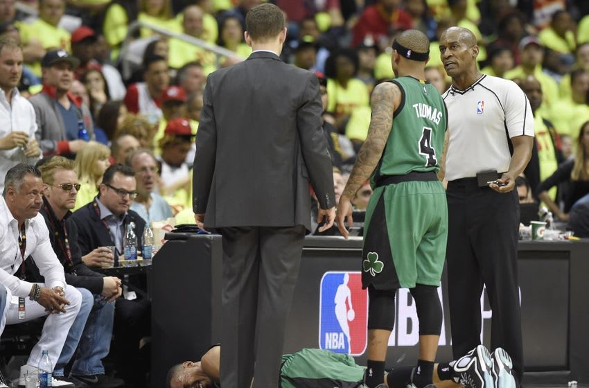 Apr 16, 2016; Atlanta, GA, USA; Boston Celtics guard Avery Bradley (0) lays on the court after an injury against the Atlanta Hawks during the second half in game one of the first round of the NBA Playoffs at Philips Arena. Mandatory Credit: John David Mercer-USA TODAY Sports