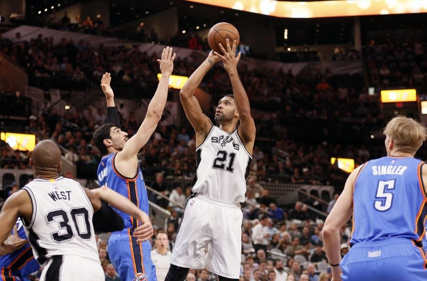 Apr 12, 2016; San Antonio, TX, USA; San Antonio Spurs power forward Tim Duncan (21) shoots the ball over Oklahoma City Thunder center Enes Kanter (11, left) during the first half at AT&T Center. Mandatory Credit: Soobum Im-USA TODAY Sports