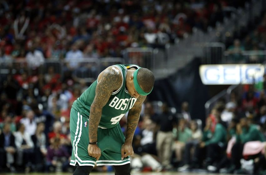 Apr 19, 2016; Atlanta, GA, USA; Boston Celtics guard Isaiah Thomas (4) rests as an Atlanta Hawks player attempts a free throw in the third quarter of game two of the first round of the NBA Playoffs at Philips Arena. The Hawks won 89-72. Mandatory Credit: Jason Getz-USA TODAY Sports