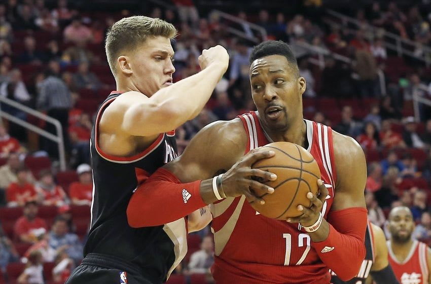 Feb 6, 2016; Houston, TX, USA; Houston Rockets center Dwight Howard (12) is guarded by Portland Trail Blazers forward Meyers Leonard (11) in the second quarter at Toyota Center. Mandatory Credit: Thomas B. Shea-USA TODAY Sports