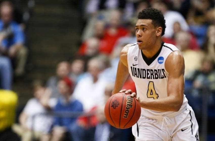 Mar 15, 2016; Dayton, OH, USA; Vanderbilt Commodores guard Wade Baldwin IV (4) dribbles the ball during the first half against the Wichita State Shockers of First Four of the NCAA men