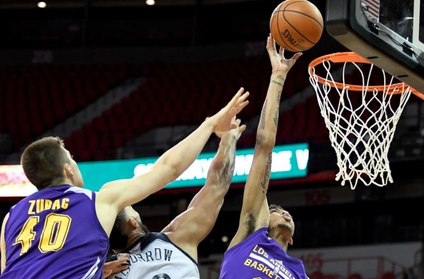 Jul 8, 2016; Las Vegas, NV, USA; Los Angeles Lakers forward Brandon Ingram (14) shoots inside the defense of New Orleans Pelicans center Liam McMorrow (50) during an NBA Summer League game at Thomas & Mack Center. Los Angeles won the game 85-65. Mandatory Credit: Stephen R. Sylvanie-USA TODAY Sports
