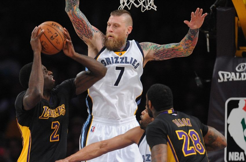 February 26, 2016; Los Angeles, CA, USA; Memphis Grizzlies forward Chris Andersen (7) defends against Los Angeles Lakers forward Brandon Bass (2) during the second half at Staples Center. Mandatory Credit: Gary A. Vasquez-USA TODAY Sports