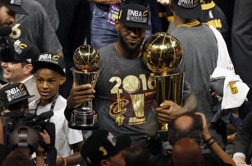 June 19, 2016; Oakland, CA, USA; Cleveland Cavaliers forward LeBron James (23) celebrates with the Larry O'Brien championship and Bill Russell MVP trophies following the 93-89 victory against the Golden State Warriors in game seven of the NBA Finals at Oracle Arena. Mandatory Credit: Cary Edmondson-USA TODAY Sports