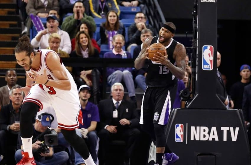 Nov 20, 2014; Sacramento, CA, USA; Sacramento Kings center DeMarcus Cousins (15) and Chicago Bulls center Joakim Noah (13) react after Noah is called for a foul against Cousins during the third quarter at Sleep Train Arena. The Sacramento Kings defeated the Chicago Bulls 103-88. Mandatory Credit: Kelley L Cox-USA TODAY Sports