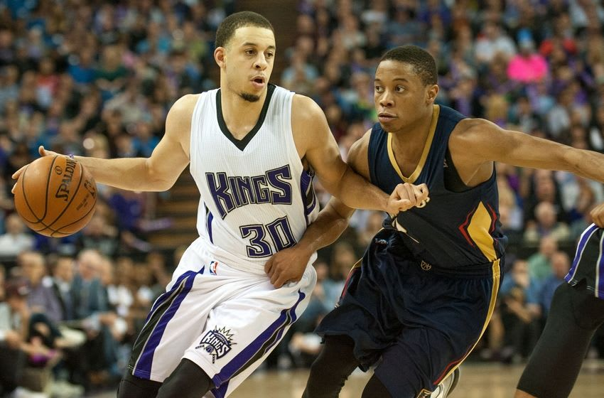 Mar 16, 2016; Sacramento, CA, USA; Sacramento Kings guard Seth Curry (30) drives to the basket against New Orleans Pelicans guard Jrue Holiday (11) during the fourth quarter at Sleep Train Arena. The Pelicans defeated the Kings 123-108. Mandatory Credit: Ed Szczepanski-USA TODAY Sports