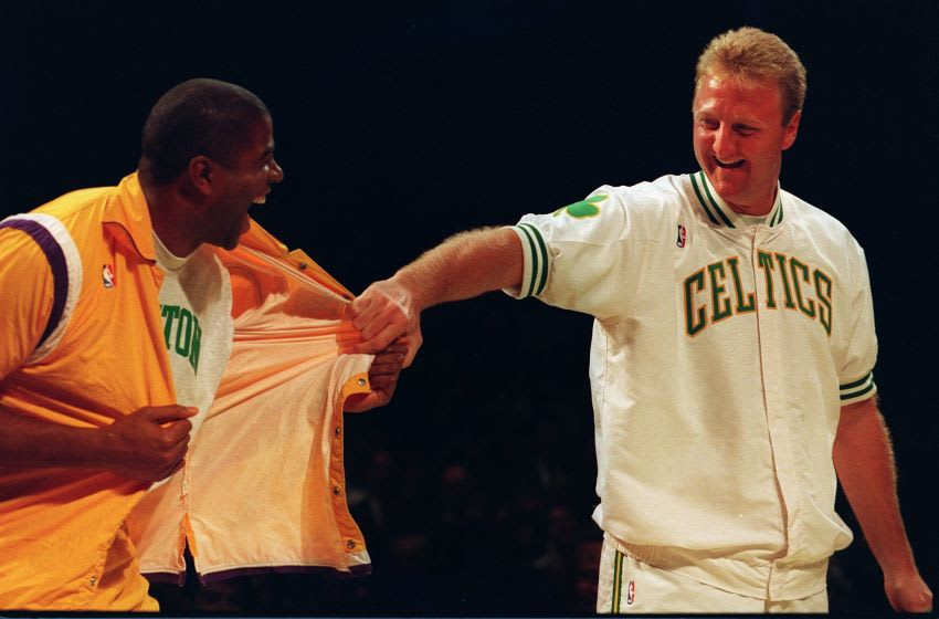 BOSTON - FEBRUARY 4: Magic Johnson, left, pays tribute to fellow basketball legend Larry Bird, who recently retired, but the joke is on Bird when he finds that Johnson has switched to a Boston shirt and given Larry a Lakers jersey. Larry Bird's career with the Boston Celtics was celebrated on Larry Bird Night at Boston Garden, Feb. 4, 1993. (Photo by Tom Herde/The Boston Globe via Getty Images)