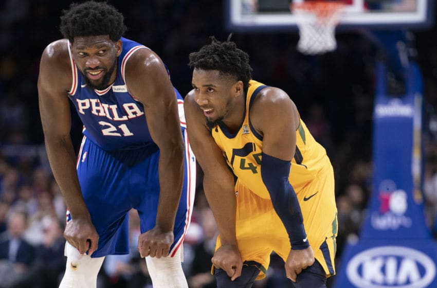 PHILADELPHIA, PA - DECEMBER 02: Joel Embiid #21 of the Philadelphia 76ers and Donovan Mitchell #45 of the Utah Jazz react at the Wells Fargo Center on December 2, 2019 in Philadelphia, Pennsylvania. NOTE TO USER: User expressly acknowledges and agrees that, by downloading and/or using this photograph, user is consenting to the terms and conditions of the Getty Images License Agreement. (Photo by Mitchell Leff/Getty Images)