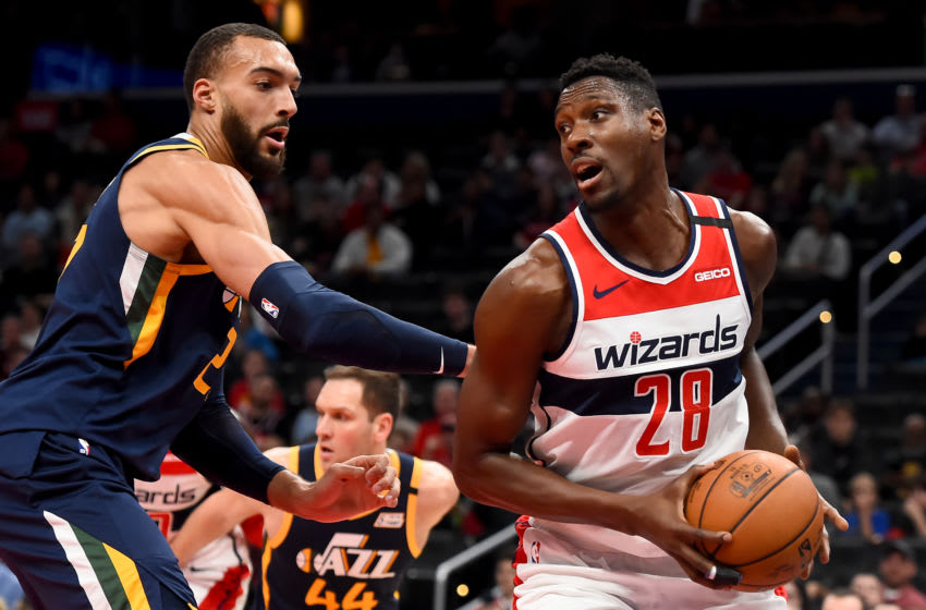 WASHINGTON, DC - JANUARY 12: Ian Mahinmi #28 of the Washington Wizards dribbles in front of Rudy Gobert #27 of the Utah Jazz during the game at Capital One Arena on January 12, 2020 in Washington, DC. NOTE TO USER: User expressly acknowledges and agrees that, by downloading and or using this photograph, User is consenting to the terms and conditions of the Getty Images License Agreement. (Photo by Will Newton/Getty Images)
