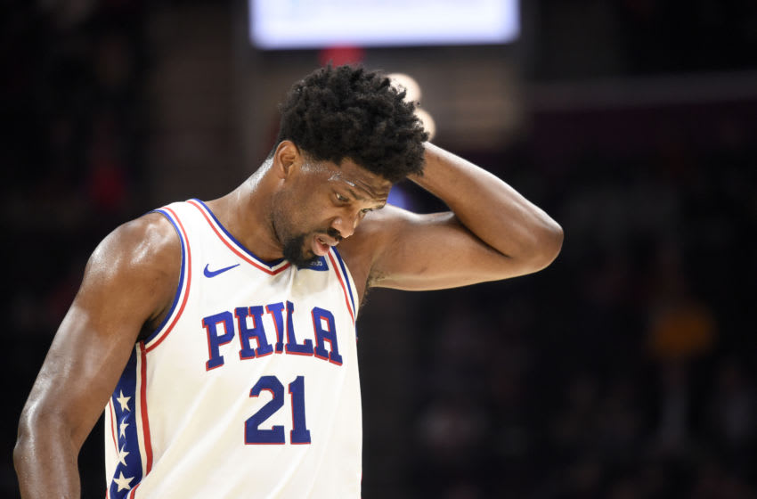 CLEVELAND, OHIO - FEBRUARY 26: Joel Embiid #21 of the Philadelphia 76ers reacts after an injury during the first half against the Cleveland Cavaliers at Rocket Mortgage Fieldhouse on February 26, 2020 in Cleveland, Ohio. NOTE TO USER: User expressly acknowledges and agrees that, by downloading and/or using this photograph, user is consenting to the terms and conditions of the Getty Images License Agreement. (Photo by Jason Miller/Getty Images)