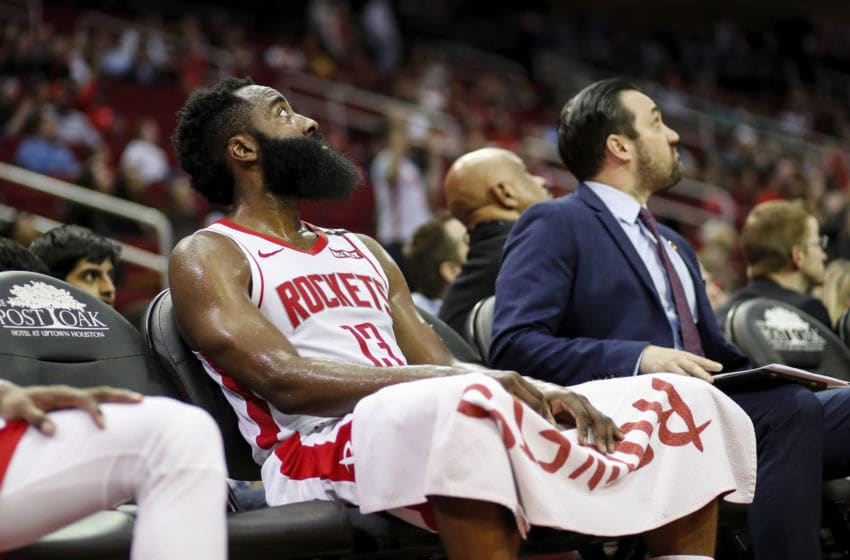 HOUSTON, TEXAS - MARCH 08: James Harden #13 of the Houston Rockets reacts on the bench in the fourth quarter against the Orlando Magic at Toyota Center on March 08, 2020 in Houston, Texas. NOTE TO USER: User expressly acknowledges and agrees that, by downloading and or using this photograph, User is consenting to the terms and conditions of the Getty Images License Agreement. (Photo by Tim Warner/Getty Images)