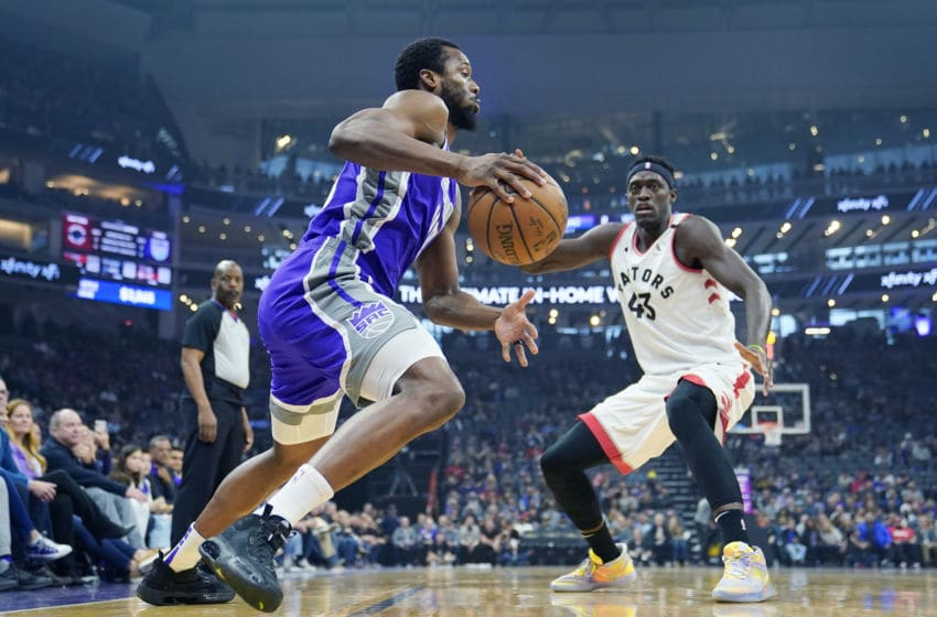 SACRAMENTO, CALIFORNIA - MARCH 08: Harrison Barnes #40 of the Sacramento Kings drives towards the basket on Pascal Siakam #43 of the Toronto Raptors during the first half of an NBA basketball game at Golden 1 Center on March 08, 2020 in Sacramento, California. NOTE TO USER: User expressly acknowledges and agrees that, by downloading and or using this photograph, User is consenting to the terms and conditions of the Getty Images License Agreement. (Photo by Thearon W. Henderson/Getty Images)