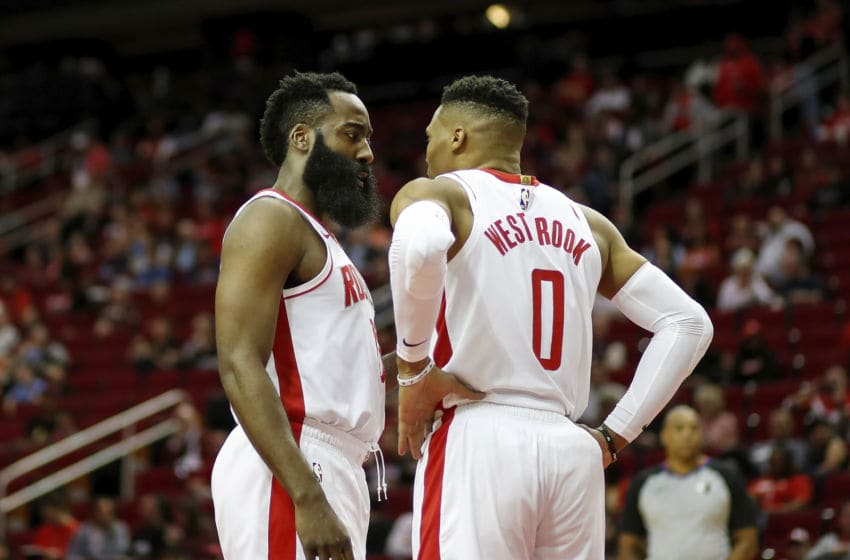 HOUSTON, TEXAS - MARCH 08: James Harden #13 of the Houston Rockets talks with Russell Westbrook #0 in the first half against the Orlando Magic at Toyota Center on March 08, 2020 in Houston, Texas. NOTE TO USER: User expressly acknowledges and agrees that, by downloading and or using this photograph, User is consenting to the terms and conditions of the Getty Images License Agreement. (Photo by Tim Warner/Getty Images)