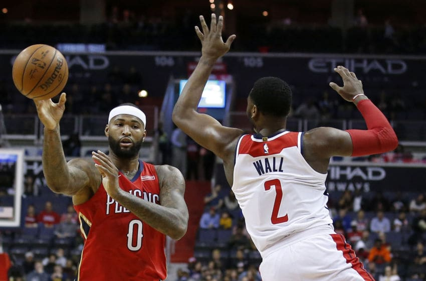 WASHINGTON, DC - DECEMBER 19: DeMarcus Cousins #0 of the New Orleans Pelicans passes the ball around John Wall #2 of the Washington Wizards in the first half at Capital One Arena on December 19, 2017 in Washington, DC. NOTE TO USER: User expressly acknowledges and agrees that, by downloading and or using this photograph, User is consenting to the terms and conditions of the Getty Images License Agreement. (Photo by Rob Carr/Getty Images)