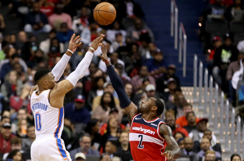 WASHINGTON, DC - NOVEMBER 02: Russell Westbrook #0 of the Oklahoma City Thunder shoots over John Wall #2 of the Washington Wizards during the second half at Capital One Arena on November 2, 2018 in Washington, DC. NOTE TO USER: User expressly acknowledges and agrees that, by downloading and or using this photograph, User is consenting to the terms and conditions of the Getty Images License Agreement. (Photo by Will Newton/Getty Images)
