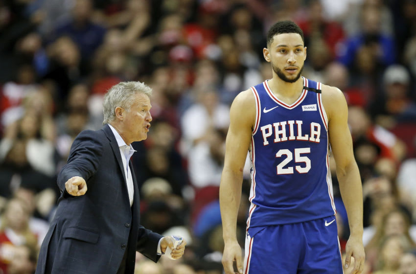 HOUSTON, TX - JANUARY 03: Brett Brown of the Philadelphia 76ers talks to Ben Simmons #25 in the first half against the Houston Rockets at Toyota Center on January 3, 2020 in Houston, Texas. NOTE TO USER: User expressly acknowledges and agrees that, by downloading and or using this photograph, User is consenting to the terms and conditions of the Getty Images License Agreement. (Photo by Tim Warner/Getty Images)