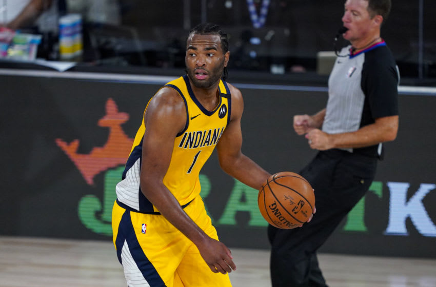 LAKE BUENA VISTA, FLORIDA - AUGUST 04: T.J. Warren #1 of the Indiana Pacers controls the ball against the Orlando Magic during the second half at Visa Athletic Center at ESPN Wide World Of Sports Complex on August 4, 2020 in Lake Buena Vista, Florida. NOTE TO USER: User expressly acknowledges and agrees that, by downloading and or using this photograph, User is consenting to the terms and conditions of the Getty Images License Agreement. (Photo by Ashley Landis-Pool/Getty Images)