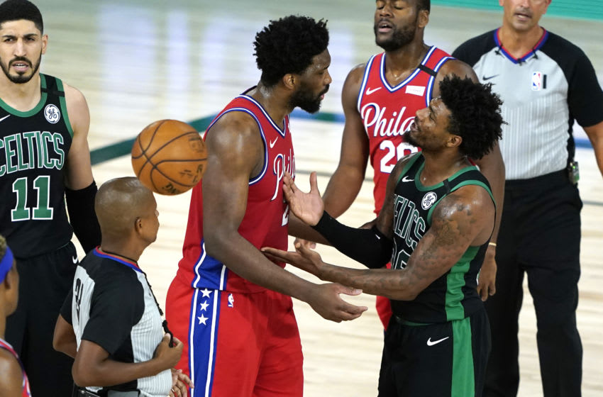 LAKE BUENA VISTA, FLORIDA - AUGUST 17: Joel Embiid #21 of the Philadelphia 76ers has words with Marcus Smart #36 of the Boston Celtics after a play during the second half at The Field House at ESPN Wide World Of Sports Complex on August 17, 2020 in Lake Buena Vista, Florida. NOTE TO USER: User expressly acknowledges and agrees that, by downloading and or using this photograph, User is consenting to the terms and conditions of the Getty Images License Agreement. (Photo by Ashley Landis - Pool/Getty Images)