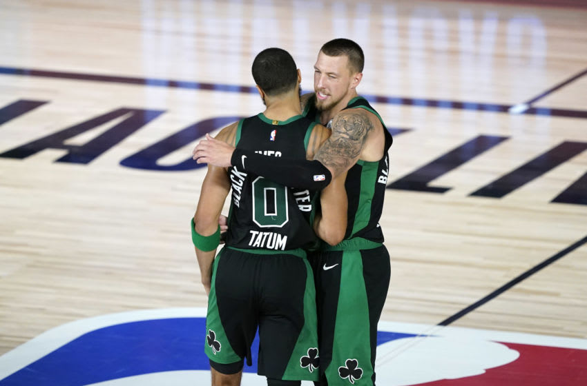LAKE BUENA VISTA, FLORIDA - AUGUST 17: Jayson Tatum #0 and Daniel Theis #27 of the Boston Celtics celebrate after Game One of the 2020 NBA Playoffs at AdventHealth Arena at the ESPN Wide World Of Sports Complex on August 17, 2020 in Lake Buena Vista, Florida. NOTE TO USER: User expressly acknowledges and agrees that, by downloading and or using this photograph, User is consenting to the terms and conditions of the Getty Images License Agreement. (Photo by Ashley Landis-Pool/Getty Images)