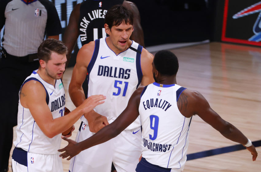 LAKE BUENA VISTA, FLORIDA - AUGUST 17: Luka Doncic #77, Boban Marjanovic #15 and Michael Kidd-Gilchrist #9 of the Dallas Mavericks celebrate a basket against the LA Clippers during the first quarter in Game One of the Western Conference First Round during the 2020 NBA Playoffs at AdventHealth Arena at ESPN Wide World Of Sports Complex on August 17, 2020 in Lake Buena Vista, Florida. (Photo by Kevin C. Cox/Getty Images)
