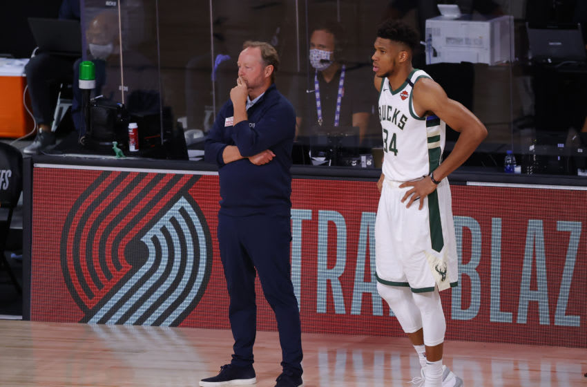 LAKE BUENA VISTA, FLORIDA - AUGUST 29: Mike Budenholzer and Giannis Antetokounmpo #34 of the Milwaukee Bucks look on against the Orlando Magic during the fourth quarter in Game Five of the Eastern Conference First Round during the 2020 NBA Playoffs at AdventHealth Arena at ESPN Wide World Of Sports Complex on August 29, 2020 in Lake Buena Vista, Florida. NOTE TO USER: User expressly acknowledges and agrees that, by downloading and or using this photograph, User is consenting to the terms and conditions of the Getty Images License Agreement. (Photo by Kevin C. Cox/Getty Images)