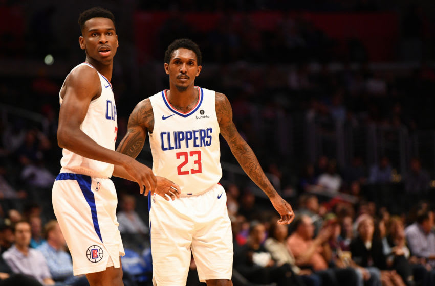 LOS ANGELES, CA - OCTOBER 09: Los Angeles Clippers Guard Shai Gilgeous-Alexander (2) looks on with Los Angeles Clippers Guard Lou Williams (23) during an NBA preseason game between the Denver Nuggets and the Los Angeles Clippers on October 9, 2018 at STAPLES Center in Los Angeles, CA.