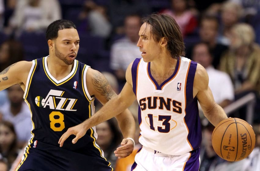 PHOENIX - OCTOBER 12: Steve Nash #13 of the Phoenix Suns looks to pass the ball during the preseason NBA game against the Utah Jazz at US Airways Center on October 12, 2010 in Phoenix, Arizona. NOTE TO USER: User expressly acknowledges and agrees that, by downloading and or using this photograph, User is consenting to the terms and conditions of the Getty Images License Agreement. (Photo by Christian Petersen/Getty Images)