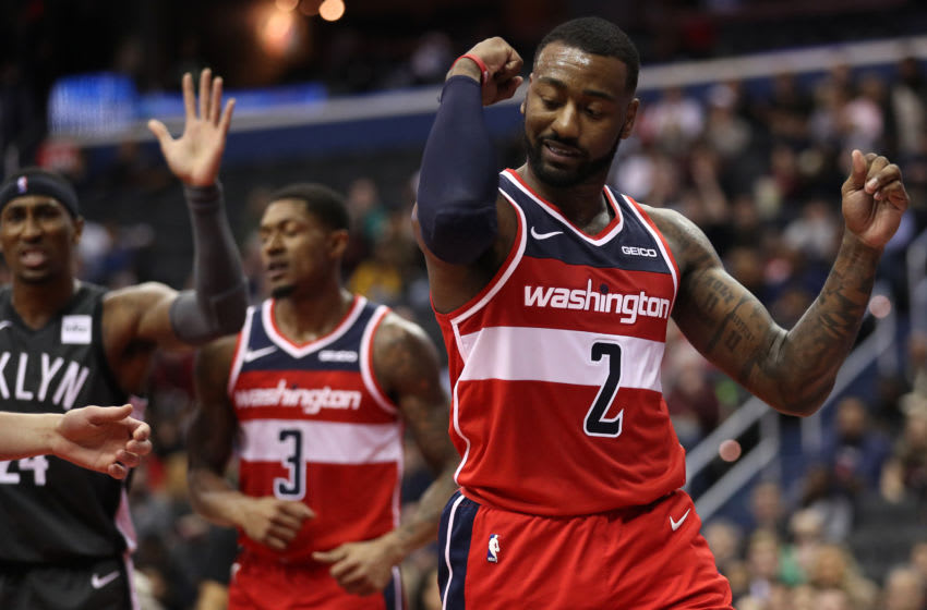 WASHINGTON, DC - DECEMBER 01: John Wall #2 of the Washington Wizards reacts against the Brooklyn Nets during the first half at Capital One Arena on December 01, 2018 in Washington, DC. NOTE TO USER: User expressly acknowledges and agrees that, by downloading and or using this photograph, User is consenting to the terms and conditions of the Getty Images License Agreement. (Photo by Patrick Smith/Getty Images)