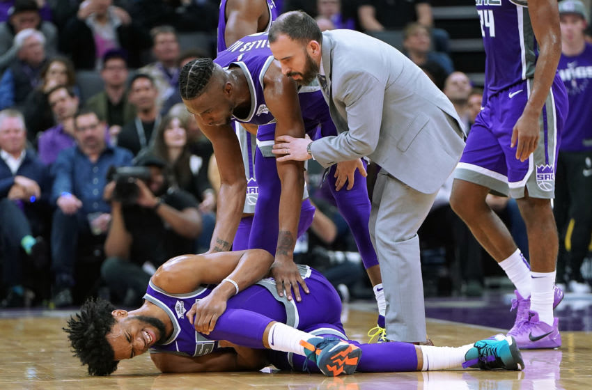 SACRAMENTO, CA - FEBRUARY 27: Marvin Bagley III #35 of the Sacramento Kings falls to the floor holding his left knee after getting hurt against the Milwaukee Bucks during the second half of an NBA basketball game at Golden 1 Center on February 27, 2019 in Sacramento, California. NOTE TO USER: User expressly acknowledges and agrees that, by downloading and or using this photograph, User is consenting to the terms and conditions of the Getty Images License Agreement. (Photo by Thearon W. Henderson/Getty Images)